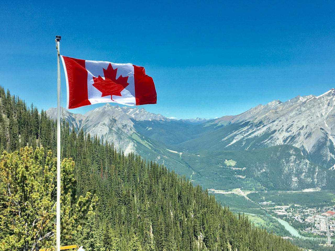 canada-flag-with-mountain-range-view