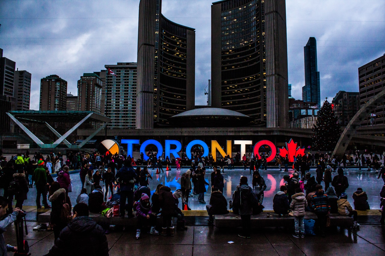 people-gathered-in-front-of-toronto-freestanding-signage